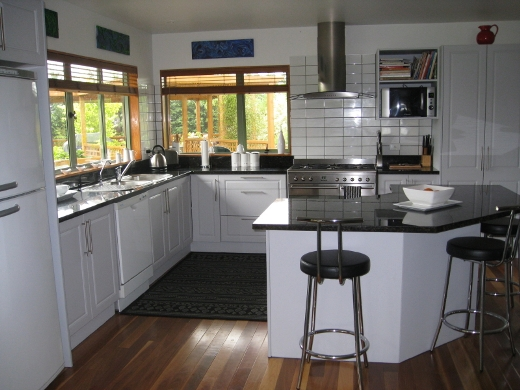 white and wood color kitchens